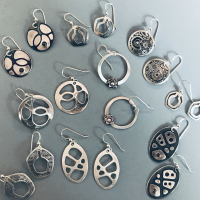 Texturing and Torch Firing Unique Silver Earrings using the Silhouette
